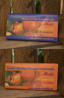 Edle Bitterschokolade Haselnuss-Nougat und Marille