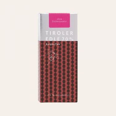 Dunkle Milchschokolade mit Bergkaffee* (Kakao: 70% mindestens). *Arabica-Kaffee aus Äthiopien  Zutaten: Kakaomasse, VOLLMILCHPULVER, Kakaobutter, 2% gemahlener Kaffee.  Ohne Zuckerzusatz, enthält von Natur aus Zucker (aus der Milch).  Spuren von Schalenobst können vorhanden sein.  Durchschnittliche Nährwerte pro 100 g: Energiewert: 2666 kJ / 644 kcal Fett: 55 g davon gesättigte Fettsäuren: 37 g Kohlenhydrate: 22 g davon Zucker: 4,1 g Eiweiß: 13 g Salz: 0,2 g Broteinheiten: 1,83